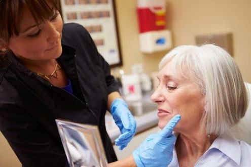 Doctor touching patient's face